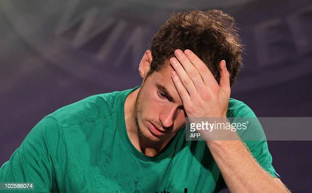 British player Andy Murray gestures during a press conference after losing to Spanish player Rafael Nadal in the men's semifinal match in the...