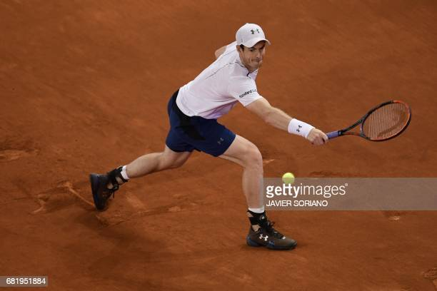 British player Andy Murray returns a ball to Croatian tennis player Borna Coric at the ATP Madrid Open in Madrid on May 11 2017 World number one Andy...
