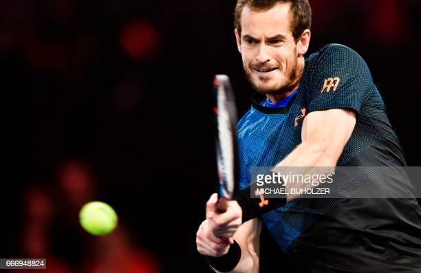 British player Andy Murray returns a shot to Swiss tennis player Roger Federer during a charity tennis match on April 10 2017 in Zurich 'The Match...