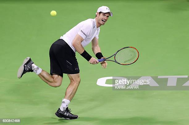 British player Andy Murray returns the ball to France's Jeremy Chardy on the fourth day of the ATP Qatar Open tennis competition in Doha on January 3...