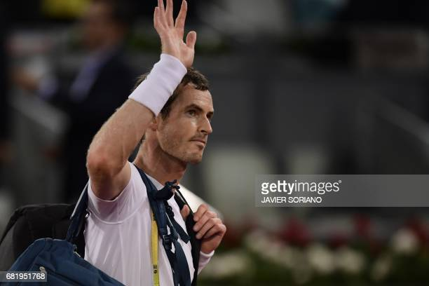 British player Andy Murray waves after being defeated by Croatian tennis player Borna Coric at the ATP Madrid Open in Madrid on May 11 2017 World...