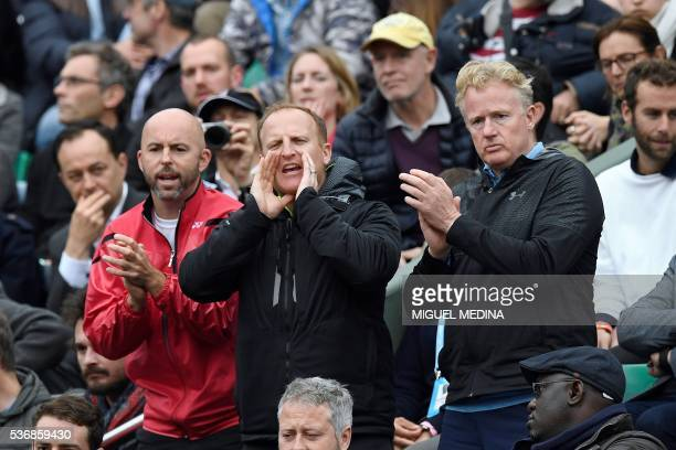British player Andy Murray's coaching team Jamie Delgado, Matt Little and Mark Bender attend during his men's quarter-final match against France's...