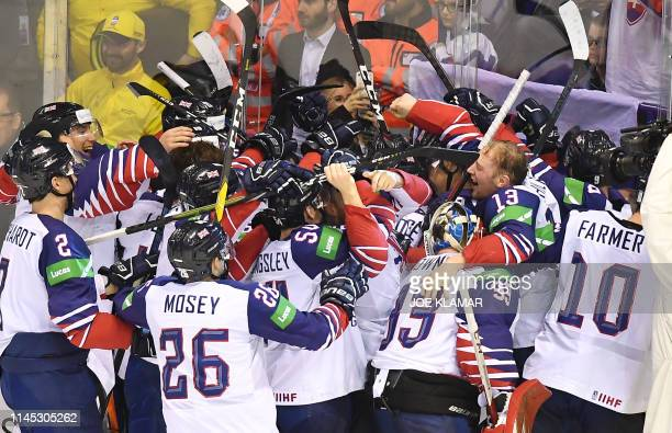British players celebrate their victory after the IIHF Men's Ice Hockey World Championships Group A match between France and Great Britain on May 20...