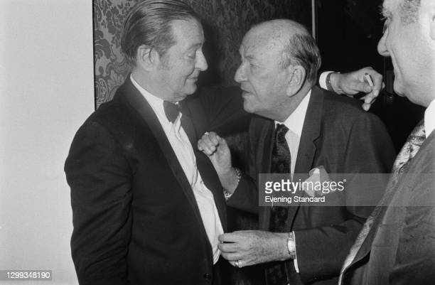 British playwright Sir Terence Rattigan and actor and director Sir Noel Coward at a party, UK, 11th January 1972.