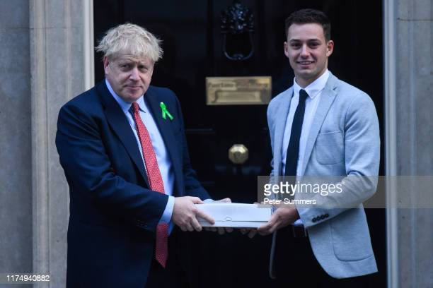 British PM Boris Johnson meets mental health campaigner Ben West on October 10 2019 in London England Mr West handed in a petition calling for...