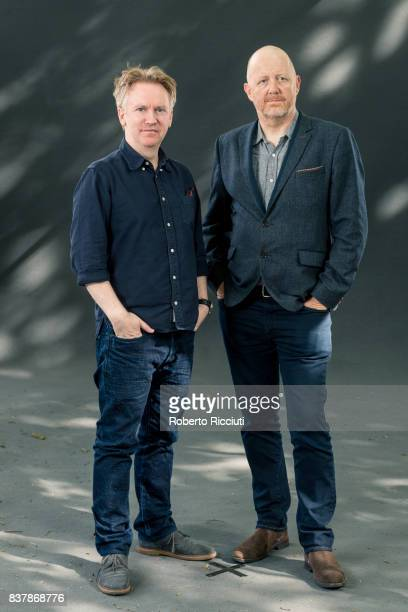 British poet writer and broadcaster Paul Farley and British poet Michael Symmons Roberts attend a photocall during the annual Edinburgh International...