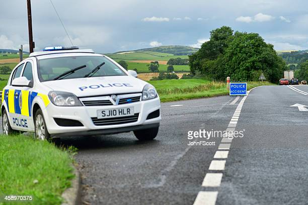 british police car parked at the side of the road - police car stock photos and pictures