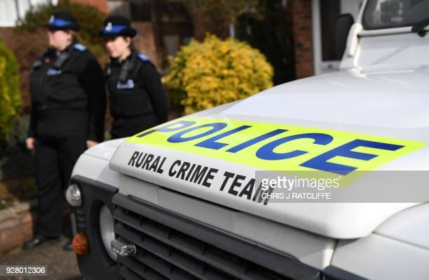British Police Community Support Officers stand on duty outside a residential property in Salisbury, southern England, on March 6 believed to have...