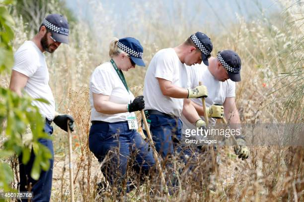 British Police continue to search scrubland as part of a new investigation into the disappearance Madeleine McCann on June 6 2014 in Praia da Luz...