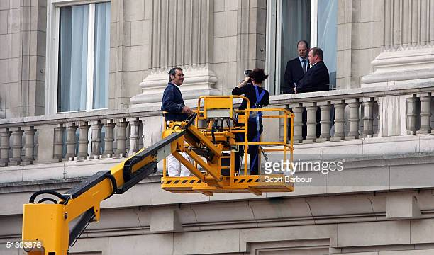 British police forensics and Buckingham Palace security take evidence from the ledge where protester Jason Hatch had climbed on the previous day on...