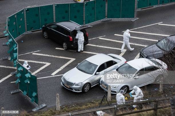 British police forensics officers inspect the scene of an incident which resulted in a West Yorkshire police officer shooting a suspect in an Audi...
