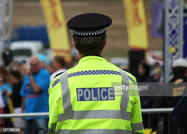 british police man backwards to the camera - british culture stock pictures, royalty-free photos & images