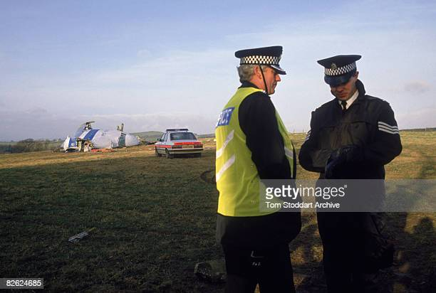 British police near some of the wreckage of Pan Am Flight 103 after it crashed onto the town of Lockerbie in Scotland 22nd December 1988 On 21st...