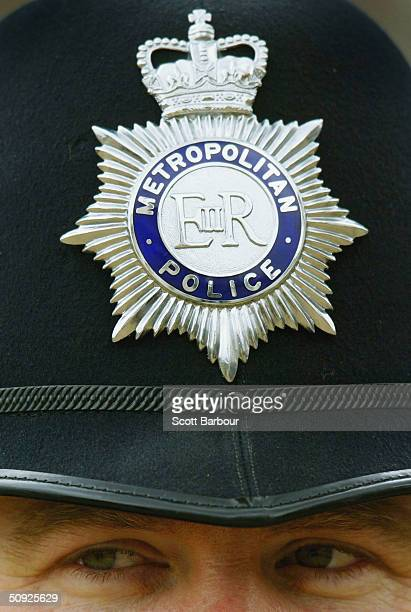 British police officer looks on during the Metropoitan Police Service's 175th Anniversary service on June 4 2004 in London England The service was...