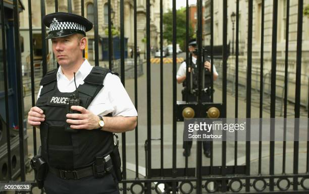 British police officer stands guard outside Downing Street after the Metropoitan Police Service's 175th Anniversary service on June 4 2004 in London...