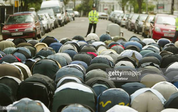 British police officer watches as followers of radical muslim cleric Abu Hamza alMasri gather for Friday prayers on May 28 2004 outside the Finsbury...