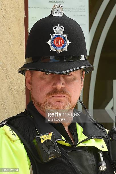 A British police officer wears a Body Worn Video camera unit as he stands on duty outside Didsbury Mosque in Didsbury Manchester northwest England on...