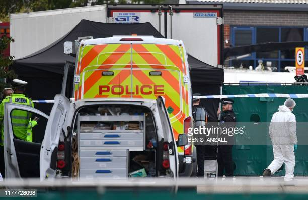 British Police officers in forsensic suits work near a lorry believed to have originated from Bulgaria and found to be containing 39 dead bodies as...
