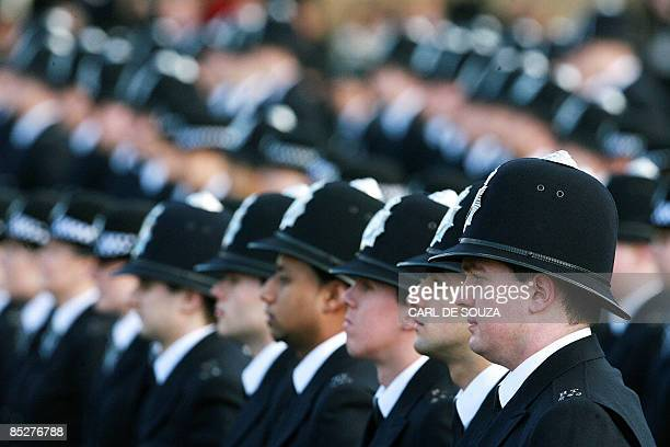 British police officers line up during a passing out parade at the Peel Centre police training complex London on March 6 2009 AFP PHOTO/Carl de Souza