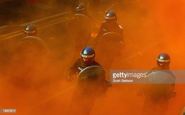 British police officers participate in a mock riot demonstration at the Metropolitan Police Specialist Training Centre April 15 2003 in Kent England...