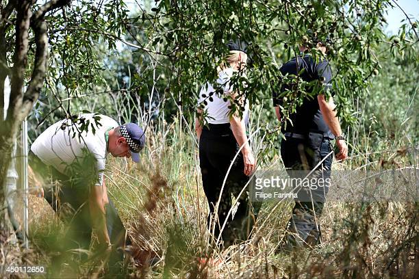 British police officers scout an area of land as part of a new investigation into the disappearance Madeleine McCann on June 5 2014 in Praia da Luz...
