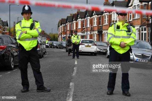 British police officers secure a cordon in a residential street in northwest London on April 28 2017 where firearms officers shot a female subject...