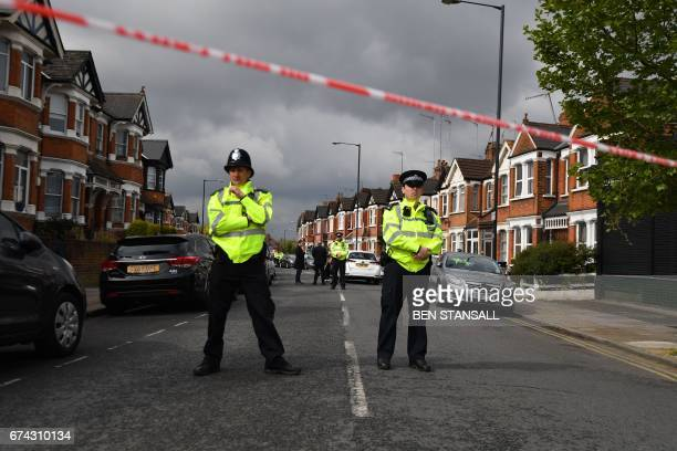 TOPSHOT British police officers secure a cordon in a residential street in northwest London on April 28 2017 where firearms officers shot a female...