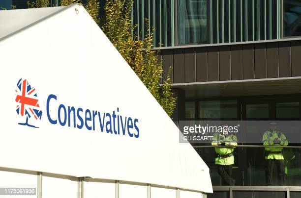 British Police officers stand on duty on the final day of the annual Conservative Party conference at the Manchester Central convention complex in...