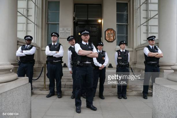 British police officers stand on duty outside the French Embassy in central London on June 18 2016 during a protest after most of an aid convoy of...