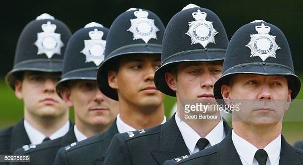 British police officers stand to attention during the Metropoitan Police Service's 175th Anniversary service on June 4 2004 in London England The...
