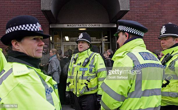 British police officers wait outside of Ipswich Magistrates Court before Stephen Wright arrives on December 22 2006 in Ipswich England Wright has...