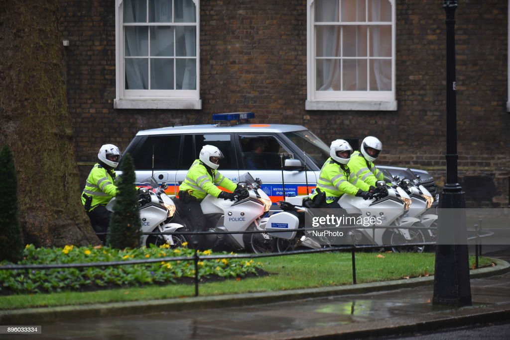British poliecem attend Prime Minister Theresa May leaves number 10, Downing Street as she heads to the House of Commons for the weekly Prime Minister's Questions session on December 20, 2017 in London, England.