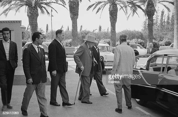 British politician and former Prime Minister Winston Churchill is helped to his car in Marrakech Morocco 1959