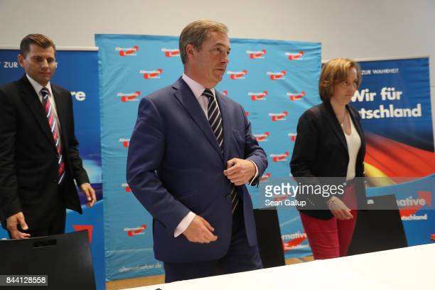 British politician and former UKIP leader Nigel Farage AfD leading member Beatrix von Storch and AfD spokesman Christian Lueth arrive at an event...