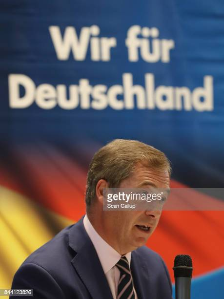 British politician and former UKIP leader Nigel Farage speaks under an election poster that reads 'We for Germany' at an event held by the German...