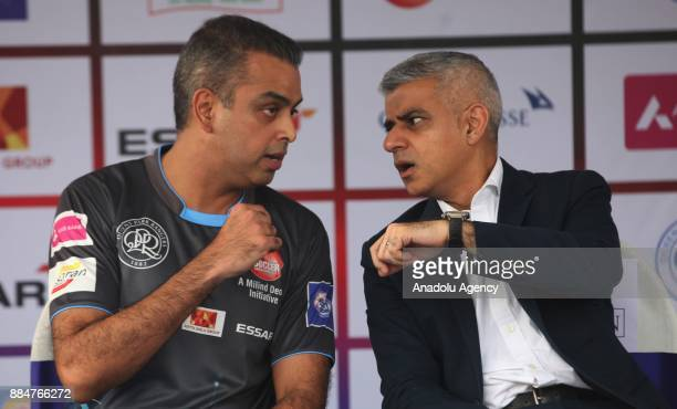 British politician and Mayor of London Sadiq Khan chats with Indian Congress Party member Milin Devra during the 9th 'QPR South Mumbai Junior Soccer...