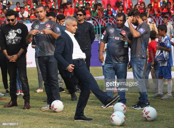 British politician and Mayor of London Sadiq Khan kicks a soccer ball during the 9th 'QPR South Mumbai Junior Soccer Challenger 2017' event in Mumbai...