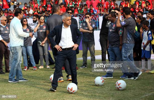 British politician and Mayor of London Sadiq Khan prepares to kick a soccer ball during the 9th 'QPR South Mumbai Junior Soccer Challenger 2017'...