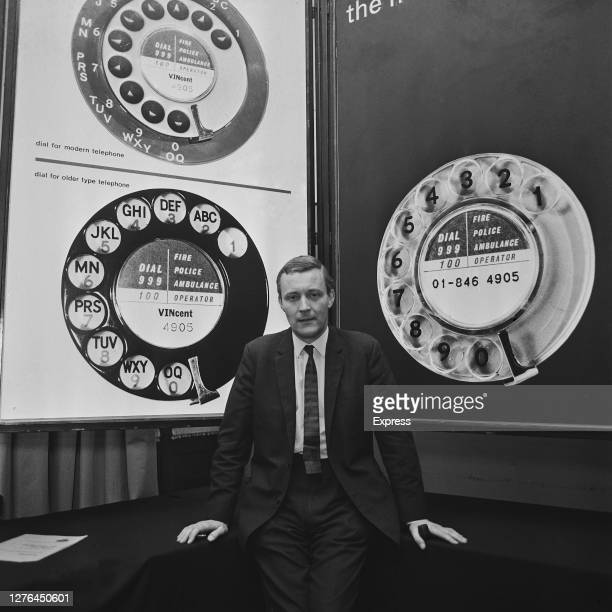 British politician Anthony Wedgwood Benn the Postmaster General unveils the new British telephone dial or 'Trimphone' UK 26th July 1965