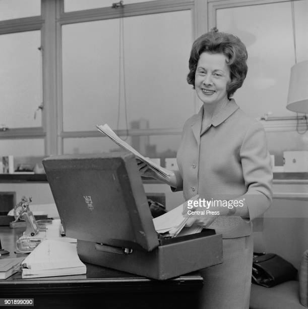 British politician Barbara Castle packs her briefcase at the Ministry of Overseas Development after being appointed Britain's first female Minister...