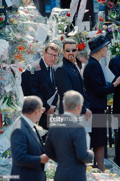 British politician David Trimble and English singer and songwriter George Michael attend the funeral of Diana Princess of Wales at Westminster Abbey...
