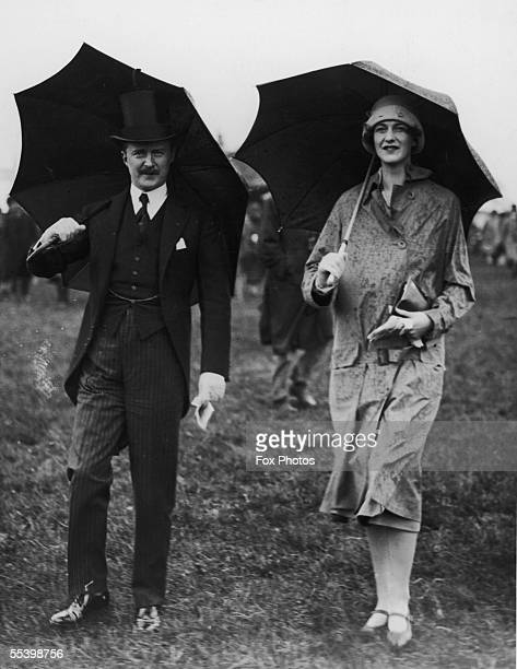 British politician, diplomat and author Alfred Duff Cooper, 1st Viscount Norwich with Lady Victor Warrender at the Derby, 1925.
