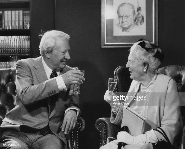 British politician Edward Heath and Clementine SpencerChurchill drink to the memory of her late husband Sir Winston Churchill at the new gallery of...