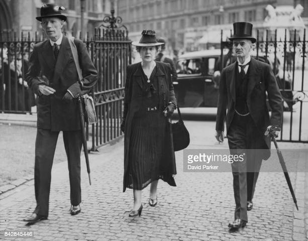 British politician Edward Wood 1st Earl of Halifax and former Prime Minister Neville Chamberlain arrive at Westminster Abbey in London with...