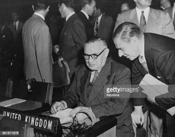 British politician Ernest Bevin the Secretary of State for Foreign Affairs with fellow English delegate Hector McNeil at the 4th United Nations...