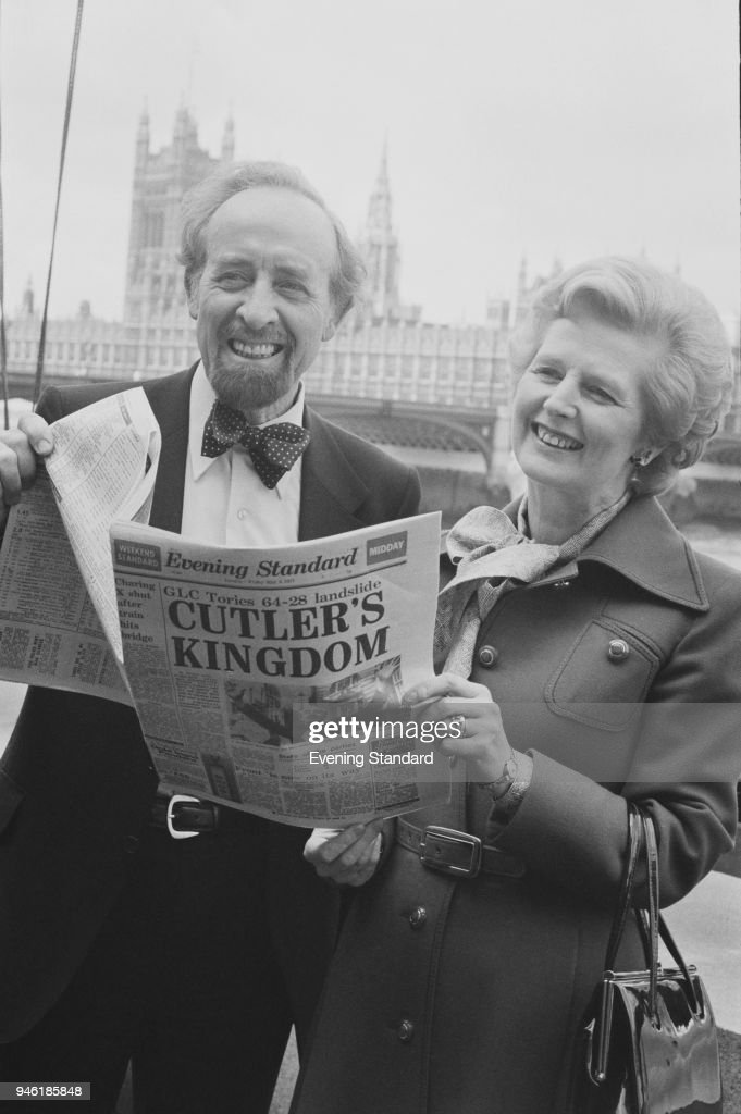 British politician Horace Cutler (1912 - 1997), who has been appointed as the new leader of the Greater London Council, celebrates with British politician and Leader of the Conservative Party Margaret Thatcher (1925 - 2013) on the banks of the River Thames, London, UK, 6th May 1977.