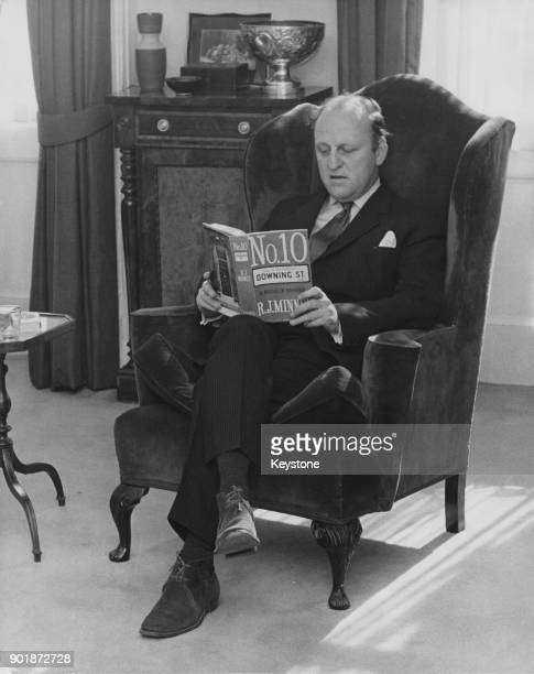 British politician Humphry Berkeley , the former MP for Lancaster, reading 'No. 10 Downing Street' by R. J. Minney at his flat in London, after...