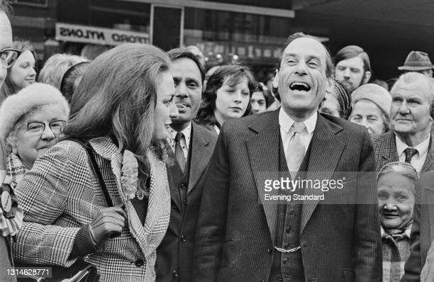 British politician Jeremy Thorpe , Leader of the Labour Party, laughing with members of the public, UK, 2nd May 1974.