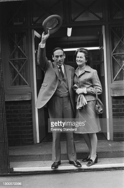 British politician Jeremy Thorpe , Leader of the Liberal Party, with his wife, pianist Marion Stein after voting in the GLC elections at the Burdett...