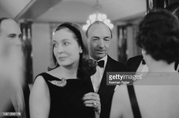 British politician John Profumo attending a party with his wife Irish actress Valerie Hobson UK 22nd March 1963
